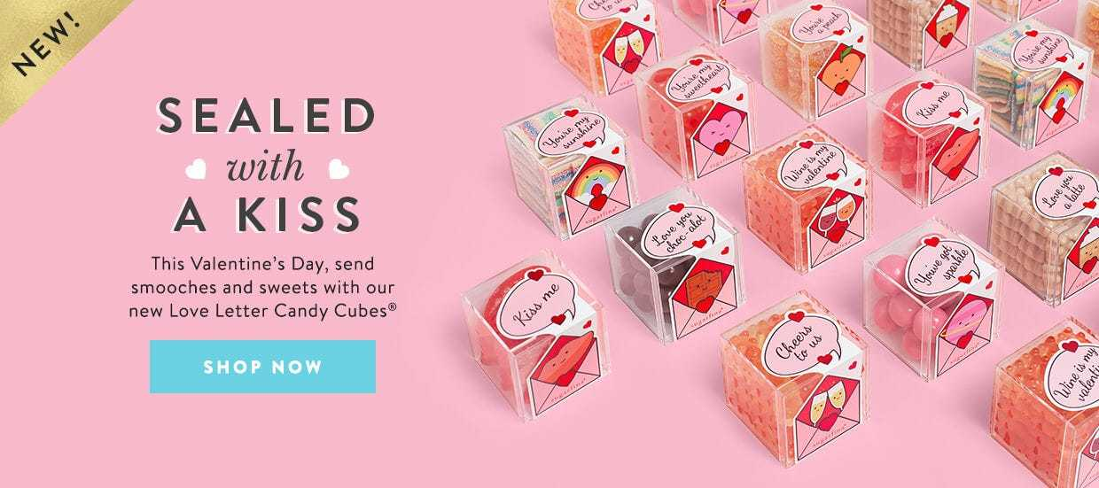 Sealed with a kiss. This Valentine's Day, send smooches and sweets with our new Love Letter Candy Cubes.