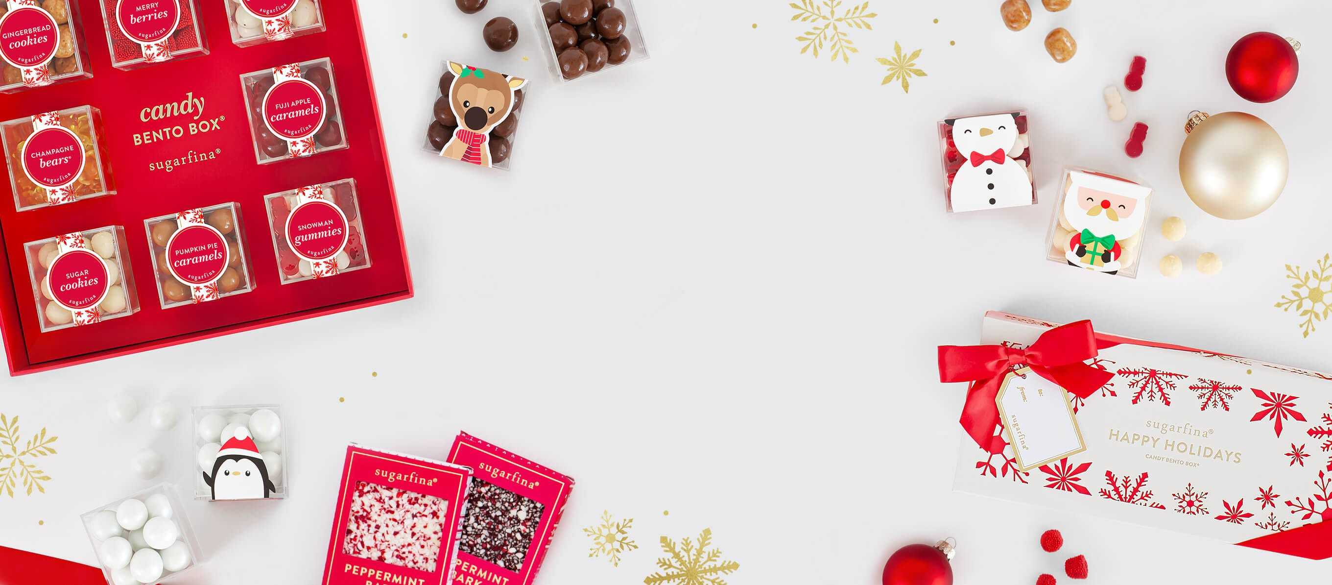 Introducing our Holiday Candy Collection featuring festive seasonal candies decorated with beautiful red and white boxes and little candy cubes of Snowmen, Santa, Reindeer and Penguins